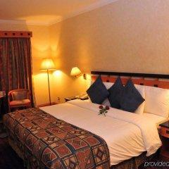 Отель Holiday International Sharjah ОАЭ, Шарджа - 5 отзывов об отеле, цены и фото номеров - забронировать отель Holiday International Sharjah онлайн комната для гостей фото 3
