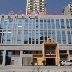 Yi Feng Business Hotel вид на фасад фото 4