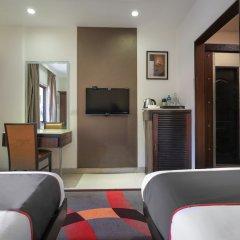 Collection O 49753 Hotel Supreme Гоа удобства в номере