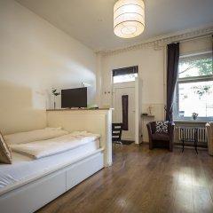 Отель Traumberg Flats Германия, Берлин - отзывы, цены и фото номеров - забронировать отель Traumberg Flats онлайн комната для гостей фото 4
