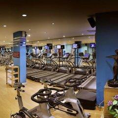 Отель The Suryaa New Delhi фитнесс-зал фото 4
