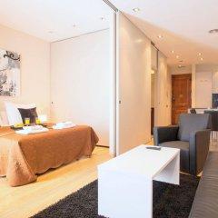 Апартаменты Plaza España Apartments Барселона комната для гостей фото 4