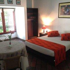 Отель Ayenda 1418 Neuchabel Колумбия, Кали - отзывы, цены и фото номеров - забронировать отель Ayenda 1418 Neuchabel онлайн комната для гостей