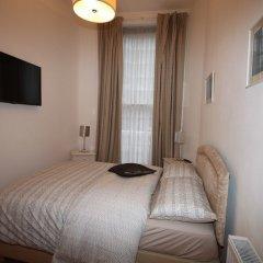 Апартаменты Belgravia Apartments - Gloucester Road комната для гостей