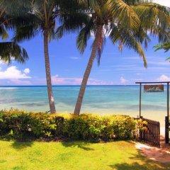 Отель Coconut Grove Beachfront Cottages пляж фото 2