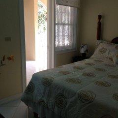 Отель Cazwin Villas Ямайка, Монтего-Бей - отзывы, цены и фото номеров - забронировать отель Cazwin Villas онлайн сейф в номере