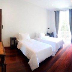 Отель Baan Manusarn Бангкок комната для гостей фото 4