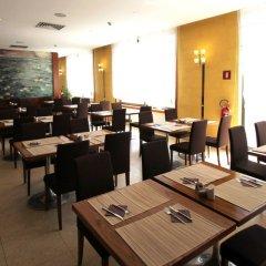 Отель MH Hotel Piacenza Fiera Италия, Пьяченца - отзывы, цены и фото номеров - забронировать отель MH Hotel Piacenza Fiera онлайн питание фото 2