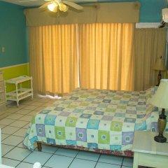 Отель Chrisanns Beach Resort Ямайка, Очо-Риос - отзывы, цены и фото номеров - забронировать отель Chrisanns Beach Resort онлайн комната для гостей фото 4