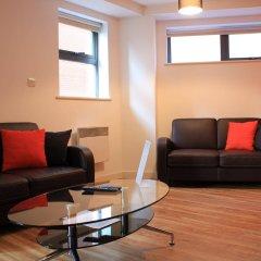 Апартаменты Atana Apartments комната для гостей