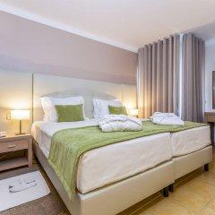 Апартаменты Santa Eulalia Apartments And Spa Албуфейра комната для гостей фото 4