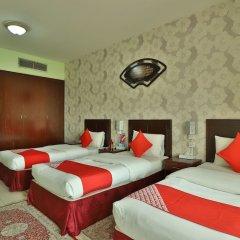 OYO 261 Remas Hotel Apartment Дубай комната для гостей фото 2