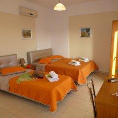 Апартаменты Pavloudis Apartments комната для гостей фото 5