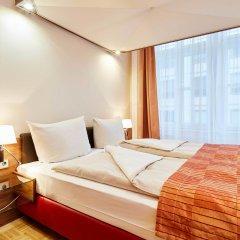 Отель Derag Livinghotel An Der Oper Вена комната для гостей
