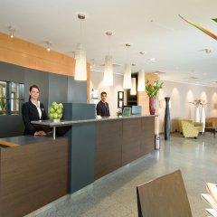Отель NH Wien City Австрия, Вена - 7 отзывов об отеле, цены и фото номеров - забронировать отель NH Wien City онлайн интерьер отеля