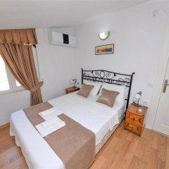 Villa Menekse Турция, Патара - отзывы, цены и фото номеров - забронировать отель Villa Menekse онлайн комната для гостей фото 2