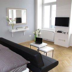 Отель Central Vienna-Living Premium Suite комната для гостей