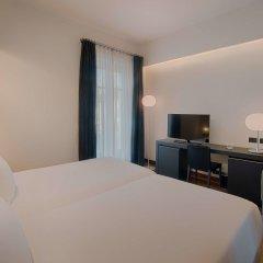 Отель NH Torino Santo Stefano Италия, Турин - 1 отзыв об отеле, цены и фото номеров - забронировать отель NH Torino Santo Stefano онлайн удобства в номере