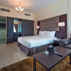 Emirates Grand Hotel Apartments Дубай комната для гостей фото 3