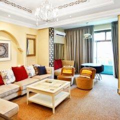Апартаменты Downtown Al Bahar Apartments Дубай комната для гостей фото 3