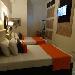 Отель Octagon Mansion Hotel Филиппины, Манила - отзывы, цены и фото номеров - забронировать отель Octagon Mansion Hotel онлайн комната для гостей фото 3