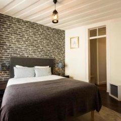 Отель Ola Lisbon - Castelo II сейф в номере
