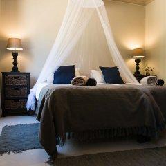 Отель Addo African Home сейф в номере