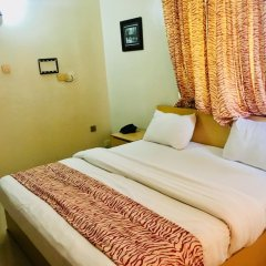 Mignonette Hotel & Suites комната для гостей фото 5