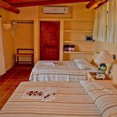 Отель Catalina Beach Resort Сиуатанехо сейф в номере