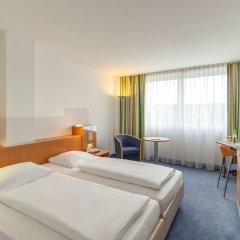 Отель Ramada by Wyndham Hannover Германия, Ганновер - отзывы, цены и фото номеров - забронировать отель Ramada by Wyndham Hannover онлайн комната для гостей фото 2