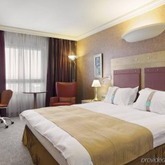 Отель Holiday Inn Attica Av. Airport West Спата комната для гостей фото 2