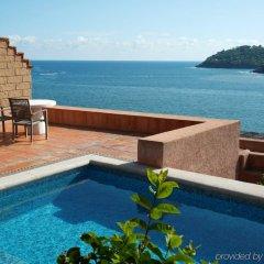 Отель La Casa Que Canta бассейн