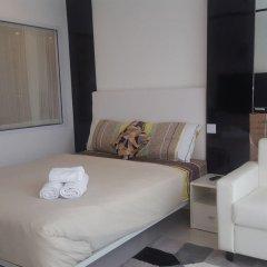 Отель City Center Residence by Pattaya Holiday Паттайя комната для гостей фото 5