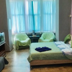 Гостиница MigApartment комната для гостей фото 5