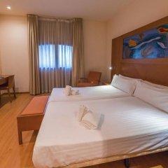Отель Checkin Valencia Валенсия сейф в номере