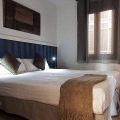 Отель MH Apartments Liceo Испания, Барселона - отзывы, цены и фото номеров - забронировать отель MH Apartments Liceo онлайн комната для гостей