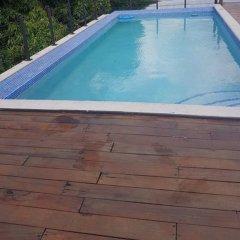 Отель Secure New Kingston Condo Ямайка, Кингстон - отзывы, цены и фото номеров - забронировать отель Secure New Kingston Condo онлайн бассейн