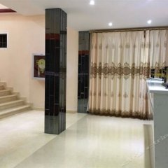 Xingfeng Hostel интерьер отеля