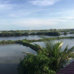 Отель Tra Que Riverside Homestay Вьетнам, Хойан - отзывы, цены и фото номеров - забронировать отель Tra Que Riverside Homestay онлайн приотельная территория