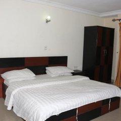 Отель Michelle Suites Нигерия, Калабар - отзывы, цены и фото номеров - забронировать отель Michelle Suites онлайн комната для гостей фото 4