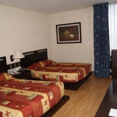 Отель Howard Johnson Plaza Las Torres Гвадалахара комната для гостей фото 4