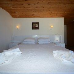Отель Villa Mercan 1 by Akdenizvillam Калкан сейф в номере
