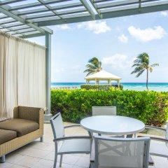 Отель Hilton Rose Hall Resort & Spa - All Inclusive Ямайка, Монтего-Бей - отзывы, цены и фото номеров - забронировать отель Hilton Rose Hall Resort & Spa - All Inclusive онлайн балкон