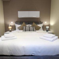 Апартаменты SS Quattro Apartment комната для гостей