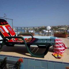 Отель 115 The Strand Suites бассейн
