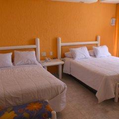 Отель Seaside Condo by Solymar комната для гостей