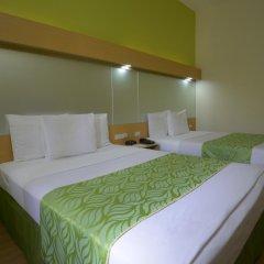 Отель Microtel Inn And Suites Davao Филиппины, Давао - отзывы, цены и фото номеров - забронировать отель Microtel Inn And Suites Davao онлайн комната для гостей фото 3