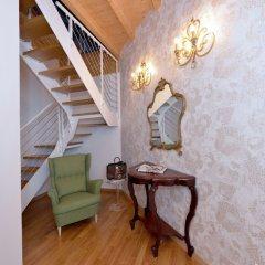 Отель Al Cappello Rosso Suite Apartments Италия, Болонья - отзывы, цены и фото номеров - забронировать отель Al Cappello Rosso Suite Apartments онлайн интерьер отеля