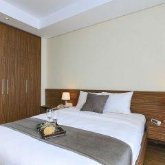 Отель Aurora Serviced Apartments - Adults Only Вьетнам, Хошимин - отзывы, цены и фото номеров - забронировать отель Aurora Serviced Apartments - Adults Only онлайн комната для гостей фото 5