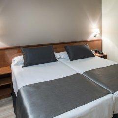 Отель Catalonia Castellnou сейф в номере